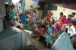 SEWA uses video to inform about microinsurance in Ahmedabad (India)
