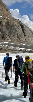 Crossing the melting glacier before climbing up to the Konkordia hut