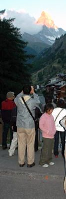Japanese tourists view the Matterhorn (Switzerland) which tectonically is part of the African plate.